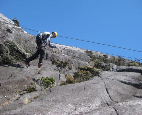 Balancing to cross the famous Nepalese Bridge